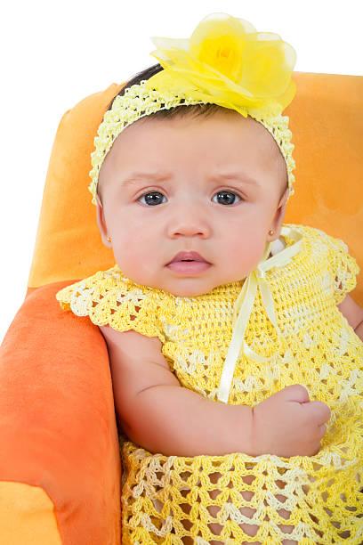hispanic baby mädchen in einem gelben kleid mit häkeldetails hand - kleinkinder kleid häkeln stock-fotos und bilder