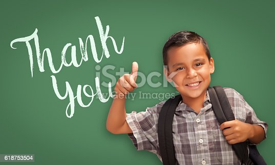 istock Hispanic Boy Gives Thumbs-up by Chalk Board with Thank You 618753504