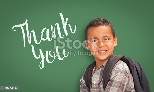 istock Hispanic Boy in Front of Chalk Board with Thank You 618754140