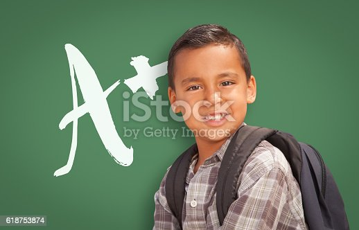 618753504 istock photo Hispanic Boy Up in Front of A Plus on Chalkboard 618753874
