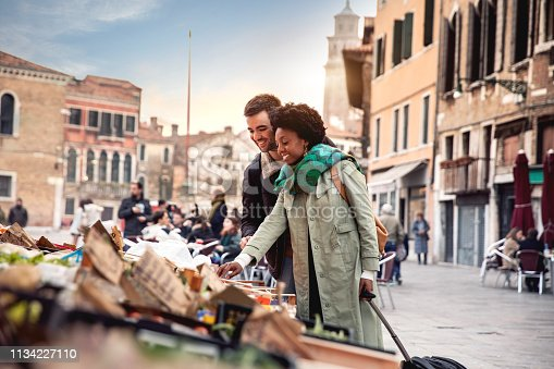 Hispanic brazilian couple enjoying an holiday vacation in Venice - Italy