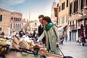 Hispanic brazilian couple enjoying an holiday vacation in Venice - Italy