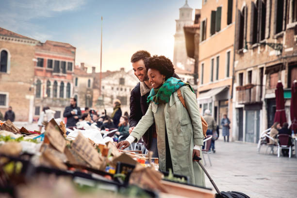 hispanic brazilian couple enjoying an holiday vacation in venice - italy - destination stock pictures, royalty-free photos & images