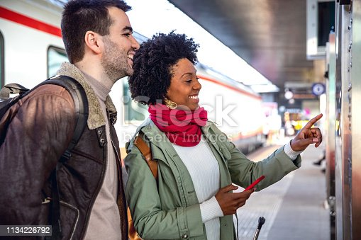 Hispanic brazilian couple in Italy - traveling county by train