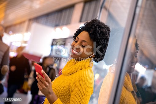 istock Hispanic brazilian woman posing in a station before leaving for a journey 1134226950