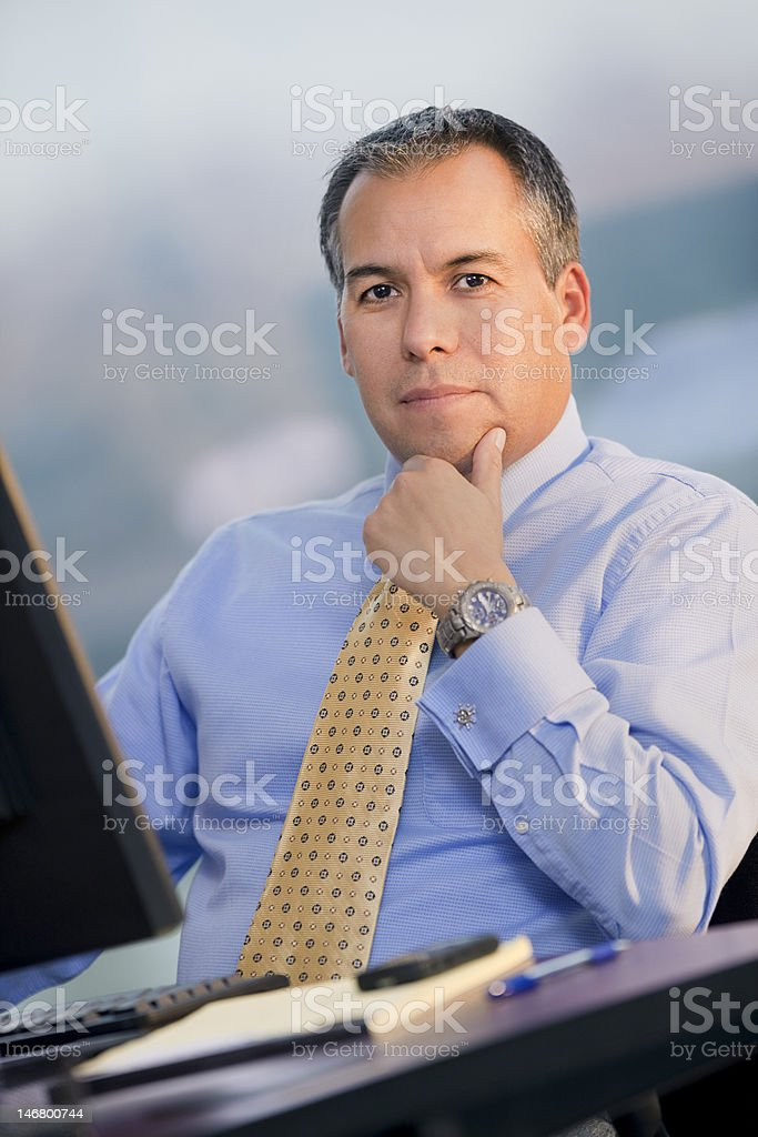 Hispanic Business Man Sitting At Desk royalty-free stock photo