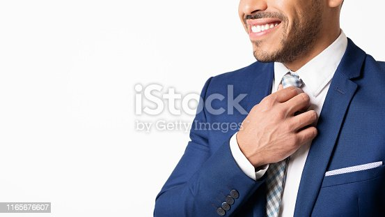 istock Hispanic Business Man Straightens His Tie On White Background, Cropped 1165676607