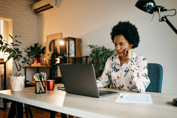 Hispanic business woman working from home stock photo
