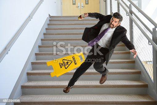 istock Hispanic Businessman Falling on stairs 485394898