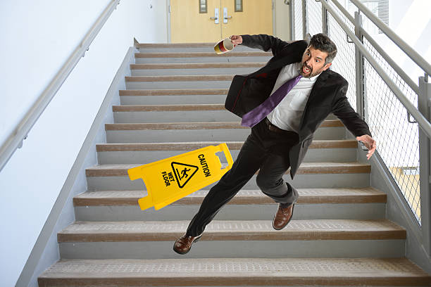 Hispanic Businessman Falling on stairs stock photo