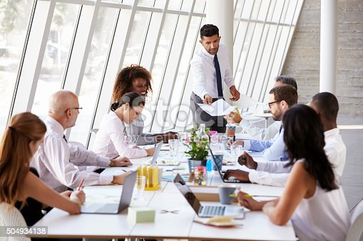 istock Hispanic Businessman Leading Meeting At Boardroom Table 504934138