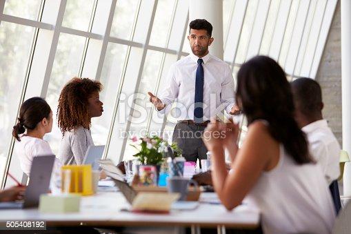istock Hispanic Businessman Leading Meeting At Boardroom Table 505408192