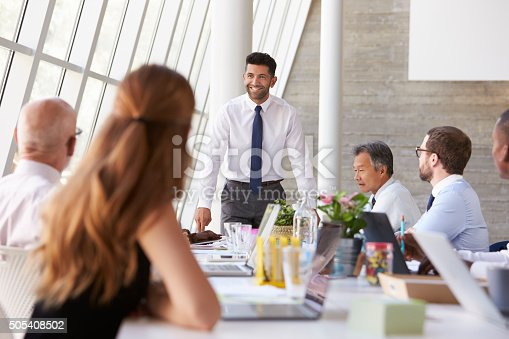 istock Hispanic Businessman Leading Meeting At Boardroom Table 505408502