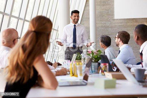 istock Hispanic Businessman Leading Meeting At Boardroom Table 505408672