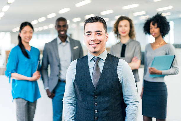 Hispanic businessman manager of a multiracial business team stock photo