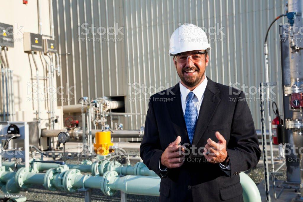 Hispanic businessman outside industrial plant royalty-free stock photo