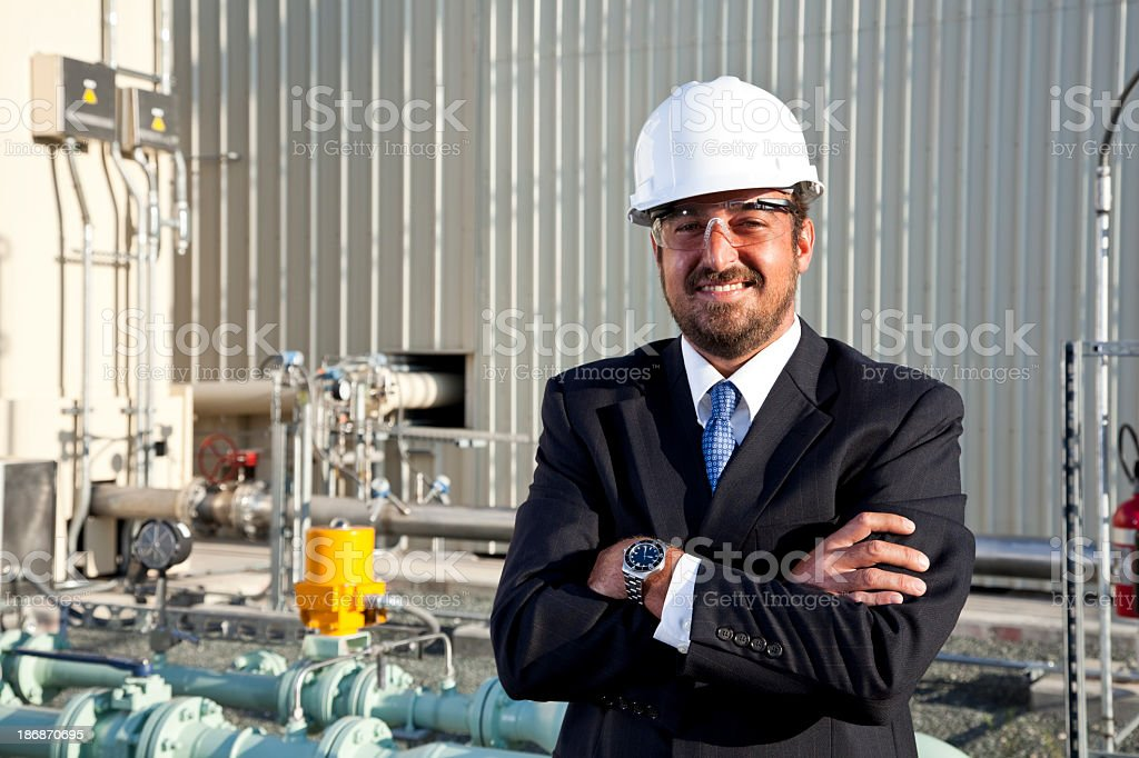 Hispanic businessman outside industrial plant royalty-free stock photo