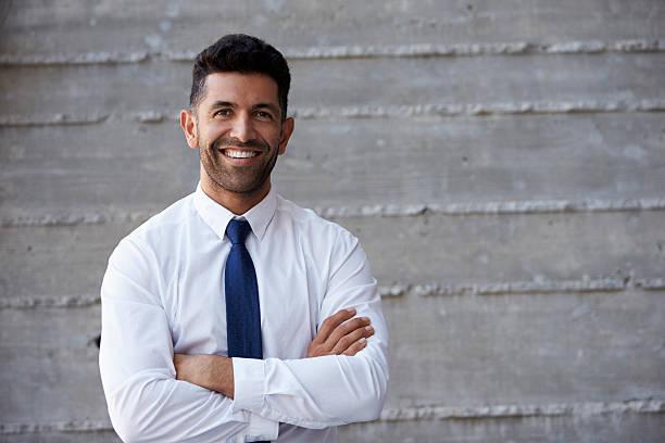 Hispanic businessman standing against wall in modern office picture id505015342?b=1&k=6&m=505015342&s=612x612&w=0&h=c9s0wau942ja2yr9arlu7pxjc7ntb3dvvysbvgwnbds=