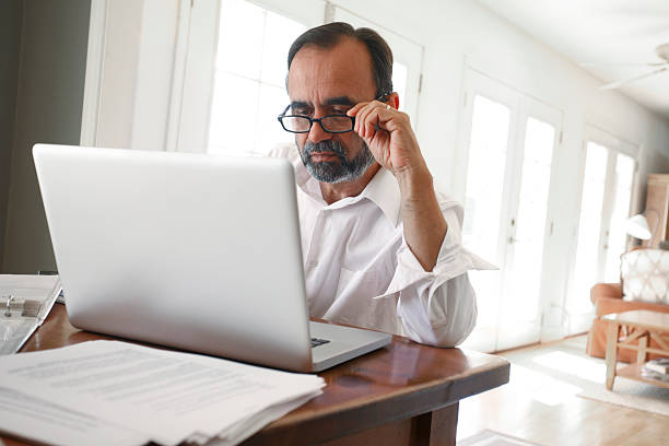 Hispanic Businessman Working From Home On Computer stock photo