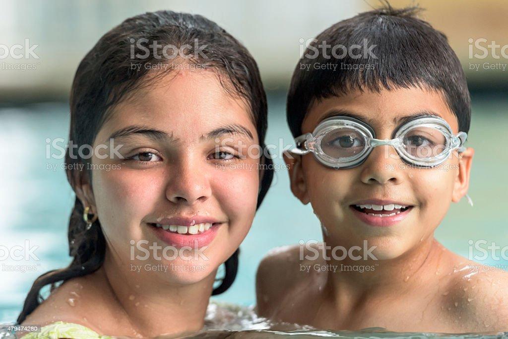 Hispanic Children Swimming stock photo