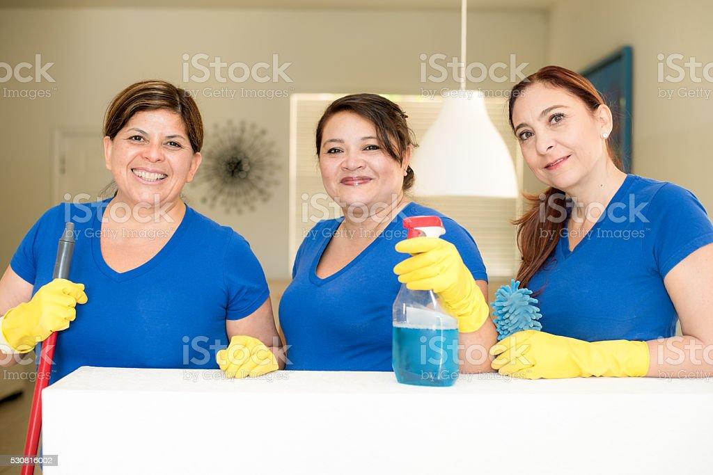 Hispanic cleaning ladies stock photo