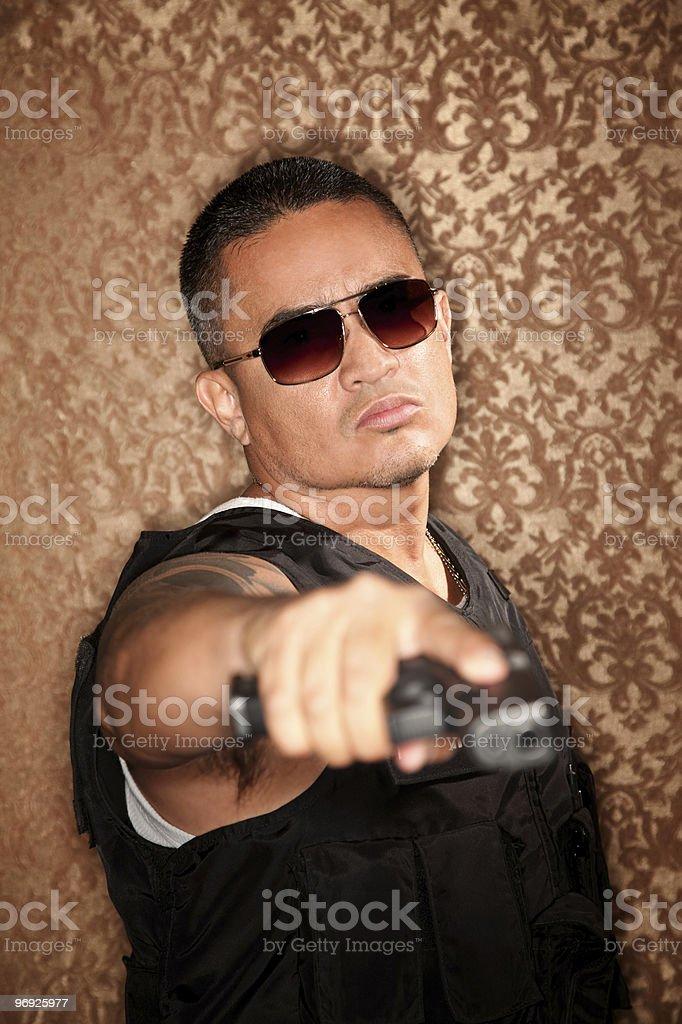 Hispanic Cop Pointing Gun royalty-free stock photo