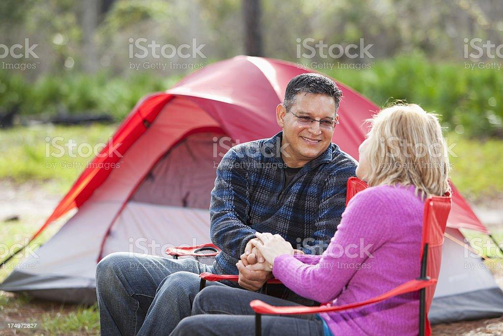 Hispanic couple camping royalty-free stock photo