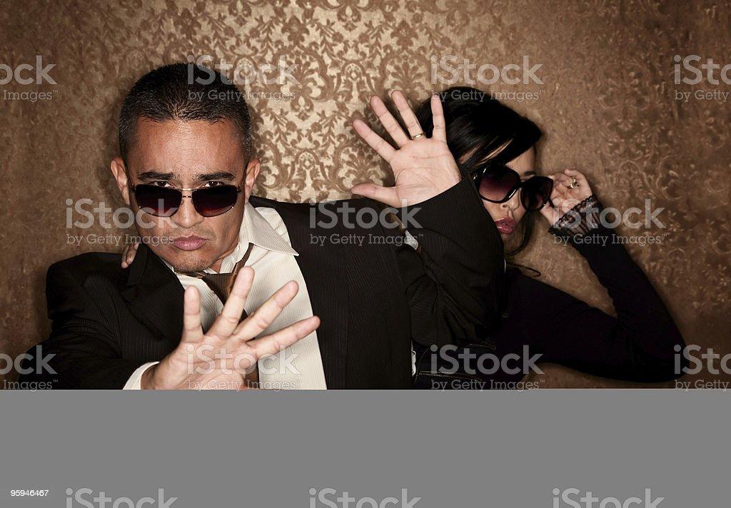 Hispanic couple caught by photographer royalty-free stock photo