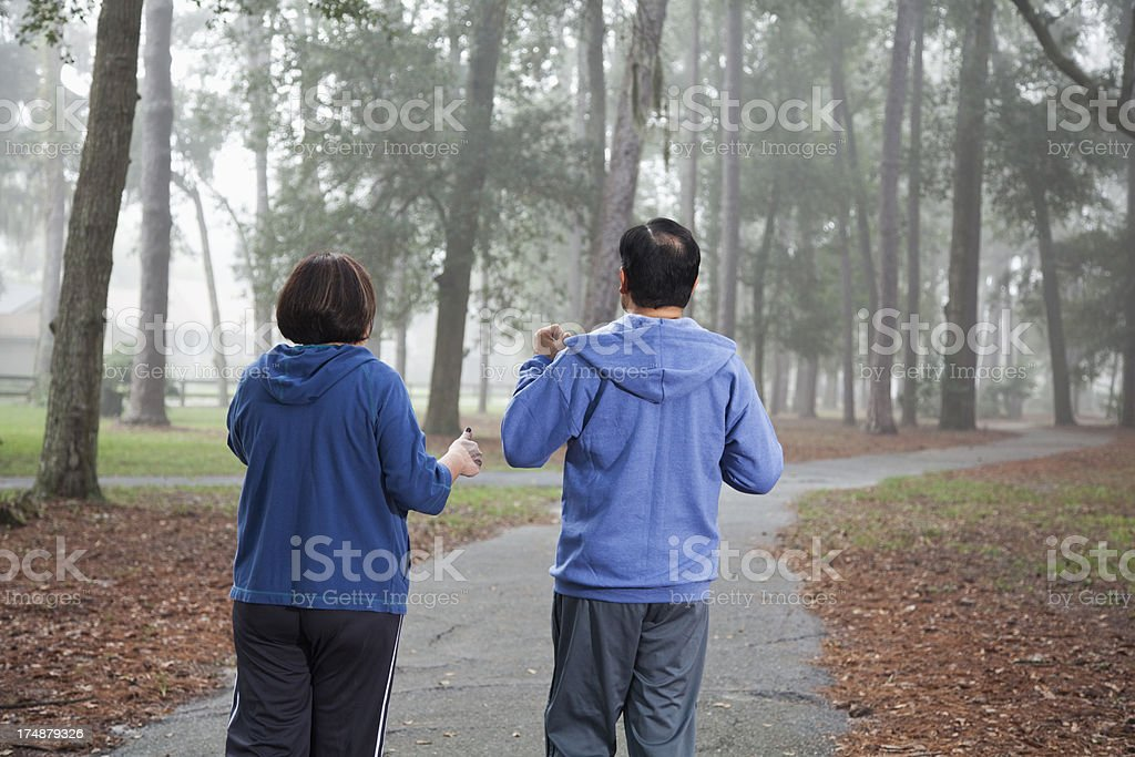 Hispanic couple exercising in the park royalty-free stock photo