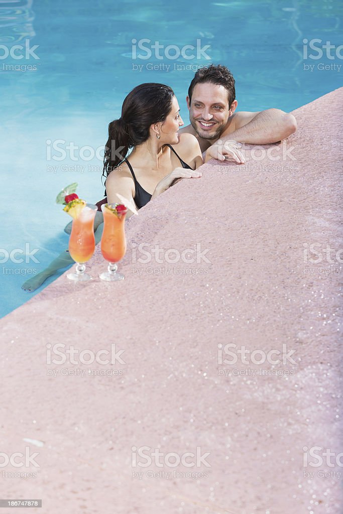 Hispanic couple in swimming pool royalty-free stock photo