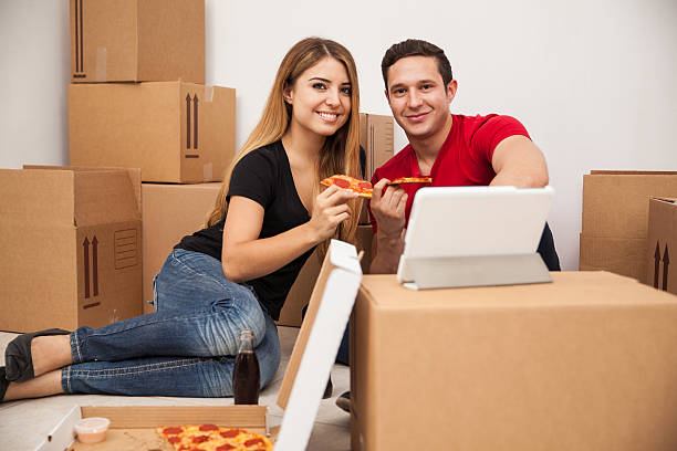 Hispanic couple moving stock photo