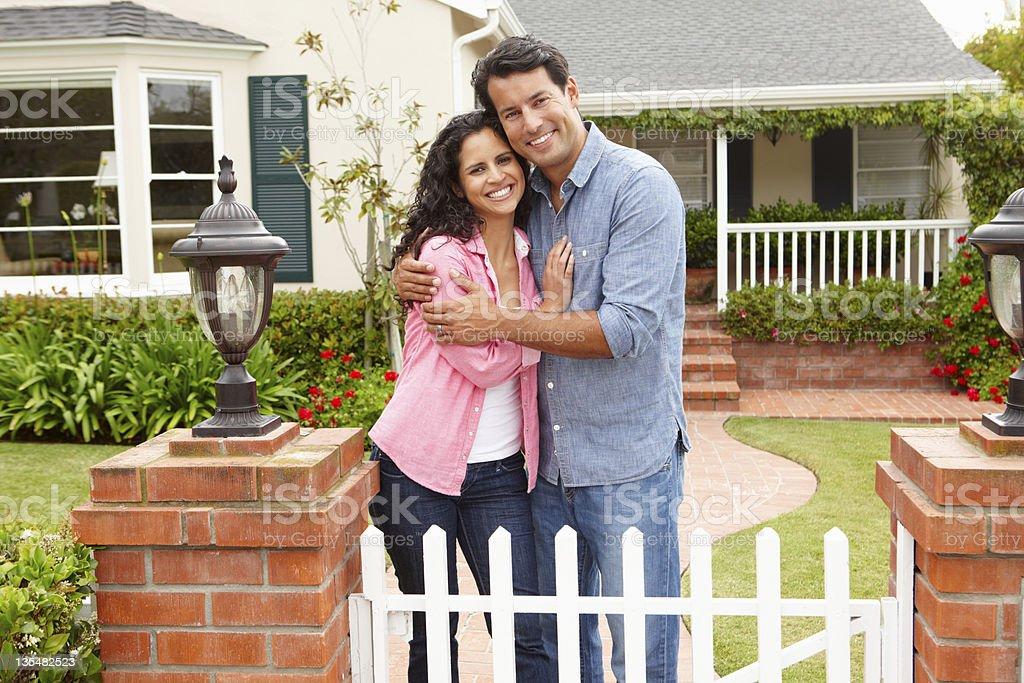 Hispanic couple outside home stock photo