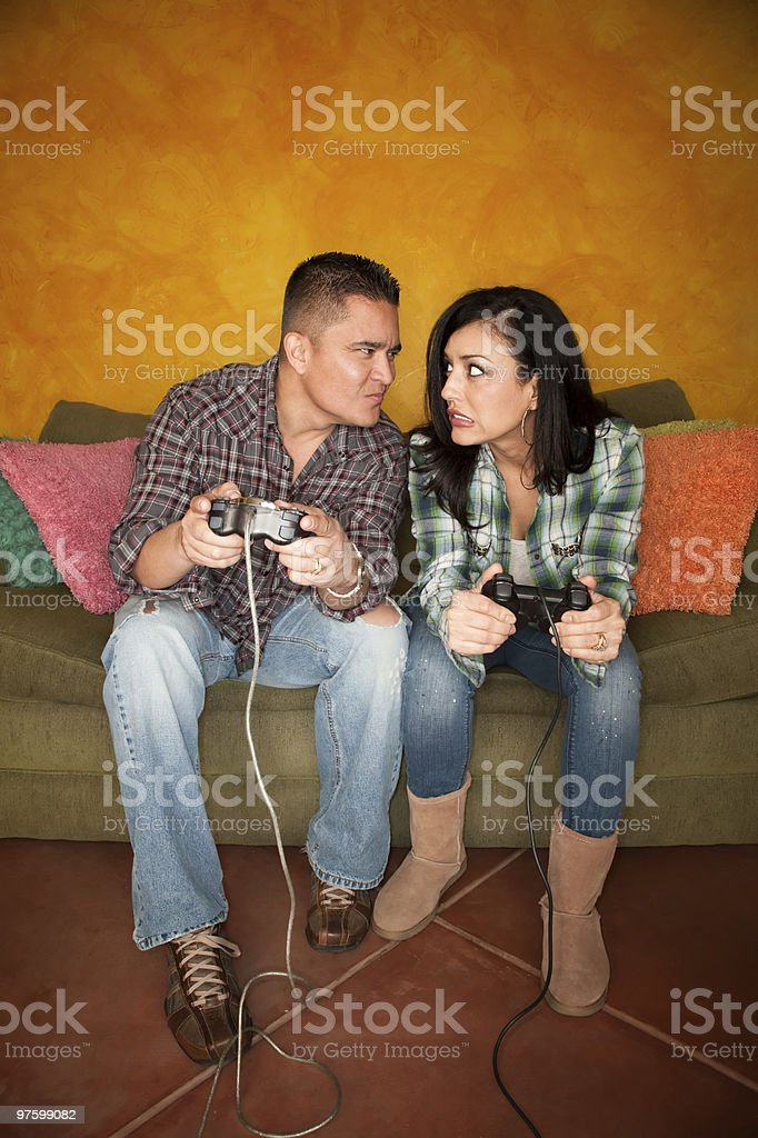 Hispanic Couple Playing Video game royalty-free stock photo