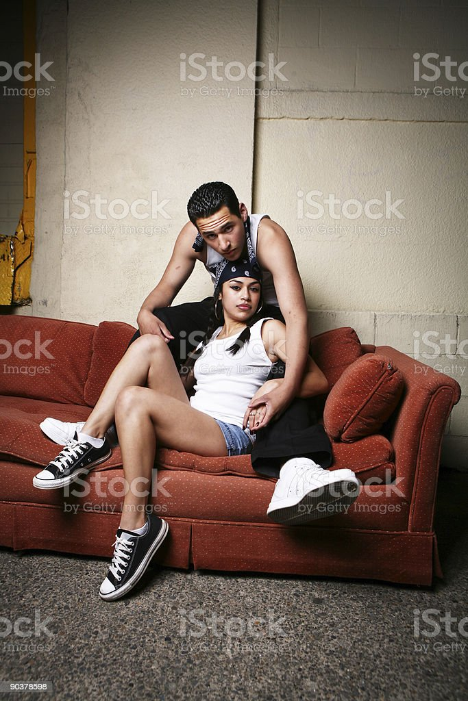 Hispanic Couple Resting on Couch royalty-free stock photo