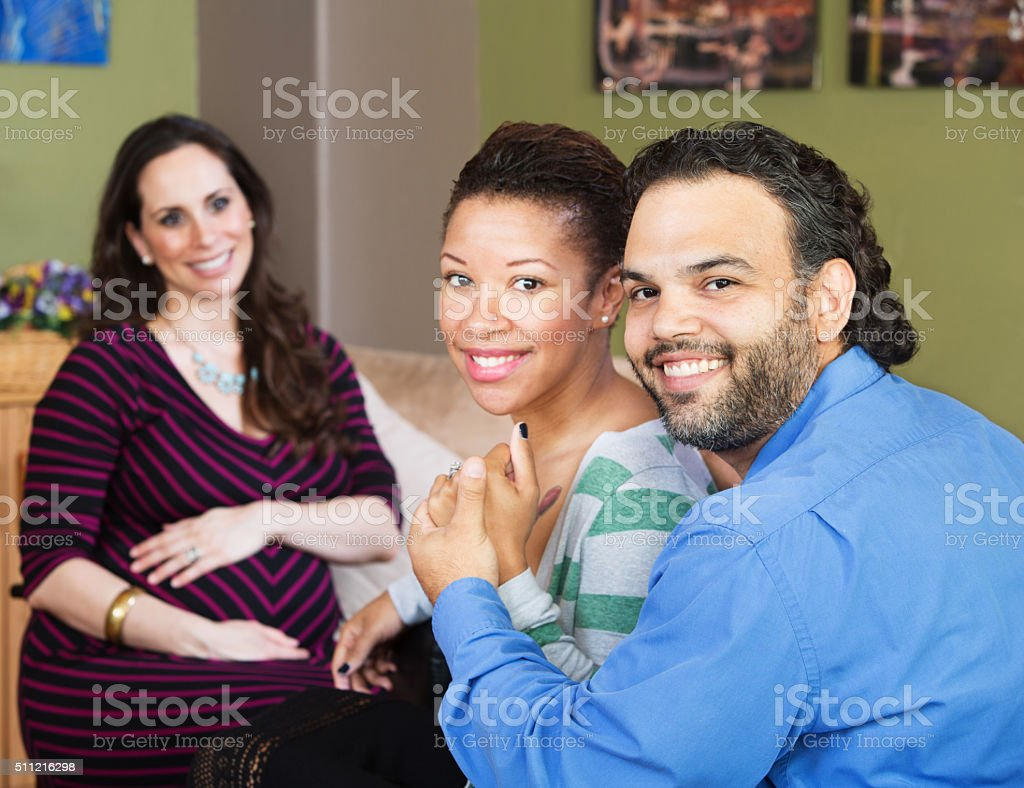 Hispanic Couple with Surrogate Mother stock photo