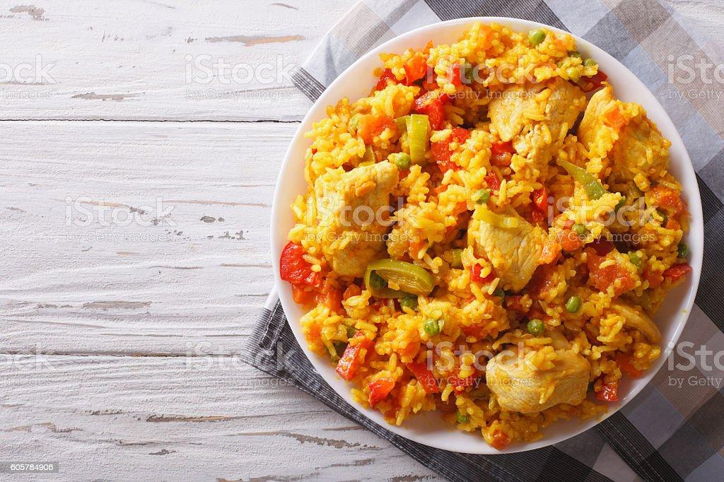 Hispanic cuisine: Arroz con pollo closeup in a bowl. Horizontal stock photo