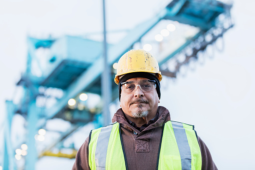 Hispanic dock worker at shipping port