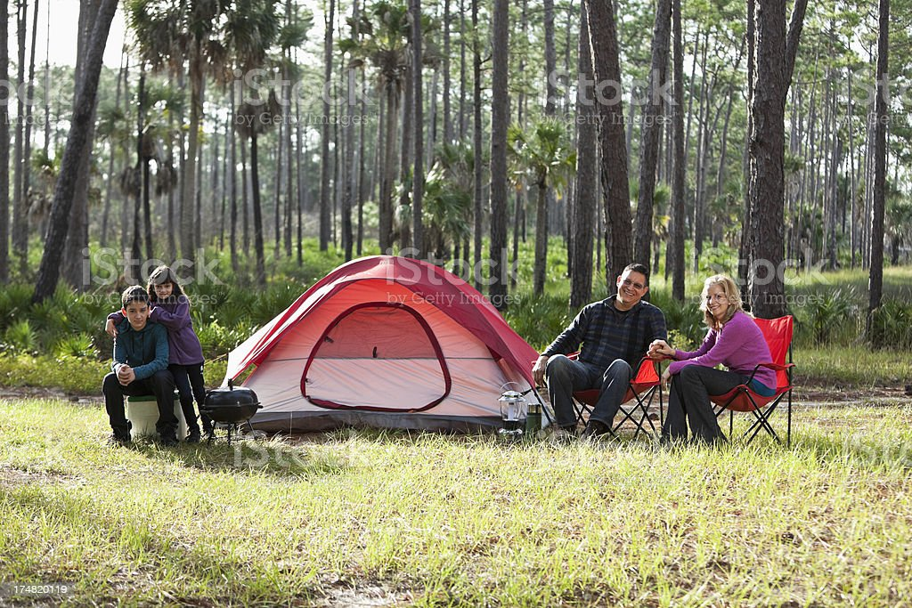 Hispanic family camping royalty-free stock photo