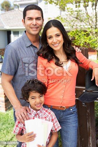 istock Hispanic Family Checking Mailbox 184602979