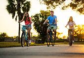 Hispanic family cycling around  the neighborhood