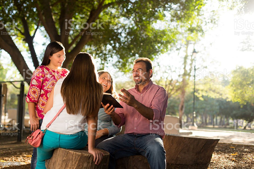Hispanic family enjoying in park stock photo