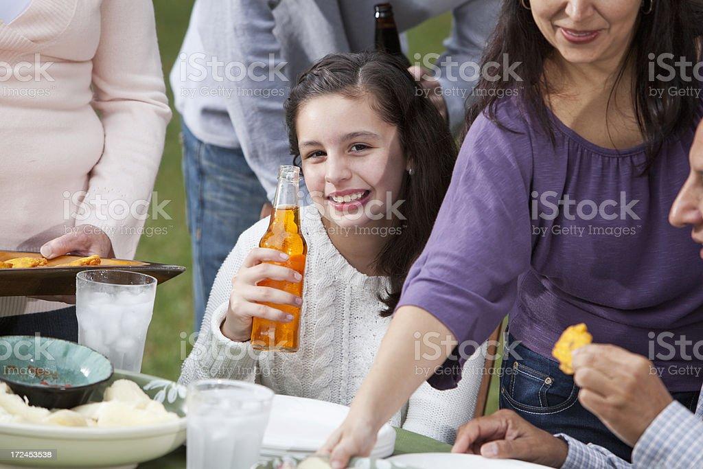 Hispanic family having cookout royalty-free stock photo
