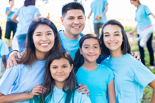 Hispanic family helps with neighborhood clean up