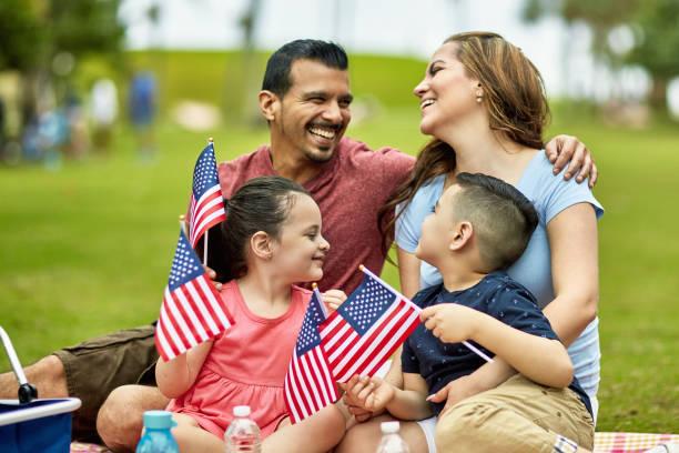 Hispanic Family Holding American Flags on Holiday stock photo