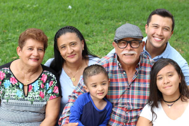 Hispanic family in the park Hispanic family in the park. latin american and hispanic ethnicity stock pictures, royalty-free photos & images
