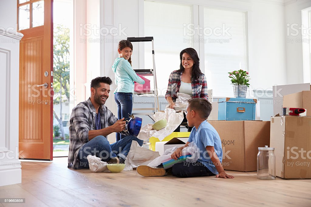Hispanic Family Moving Into New Home stock photo