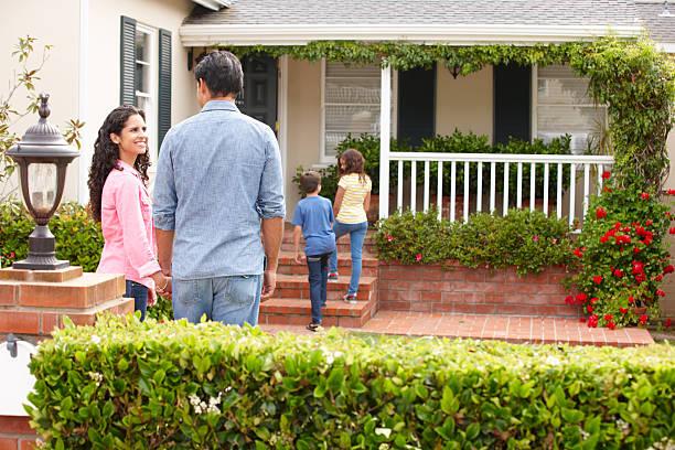Hispanic family outside home stock photo
