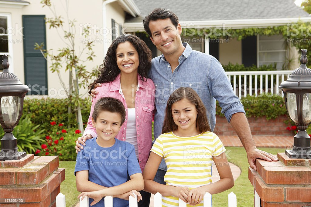 Hispanic family outside home stock photo