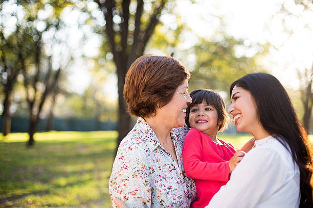 hispanic family - granddaughter and grandmother stock photos and pictures