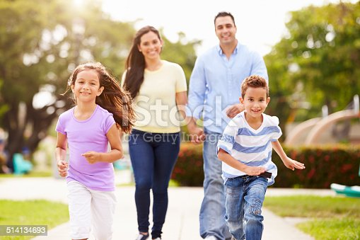 istock Hispanic Family Walking In Park Together 514134693